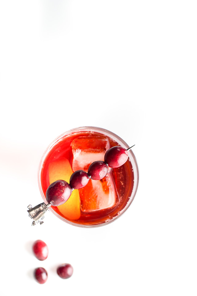 Overhead shot of red cocktail with cranberries