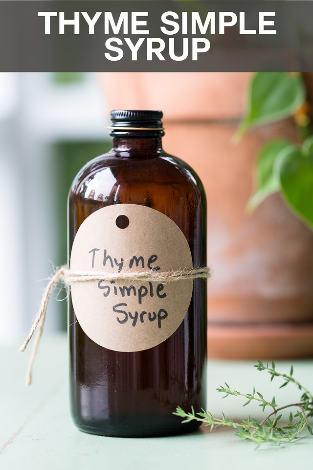 Bottle reading Thyme Simple Syrup with plant in the background