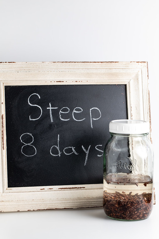 Sign that says Steep for 8 Days and a jar filled with vodka and cocao nibs.