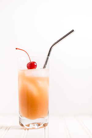 Mai Tai in a glass topped with a cherry