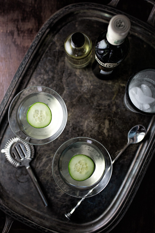 Looking down on two cocktail glasses with floating cucumber slices