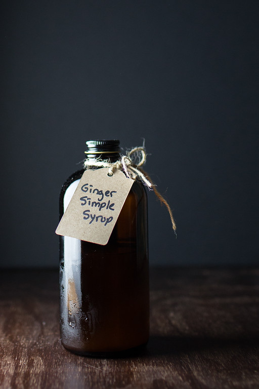 Dark brown bottle with brown tag reading ginger simple syrup.