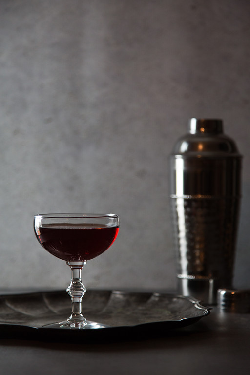 Dark red cocktail with dark silver cocktail shaker - Eeyore's Requiem