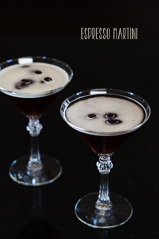 Two glasses of Espresso Martini garnished with coffee beans.