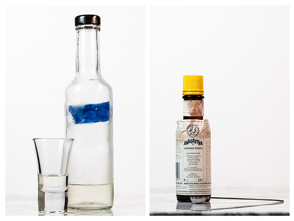 Bottle of simple syrup and bottle of Angostura bitters.