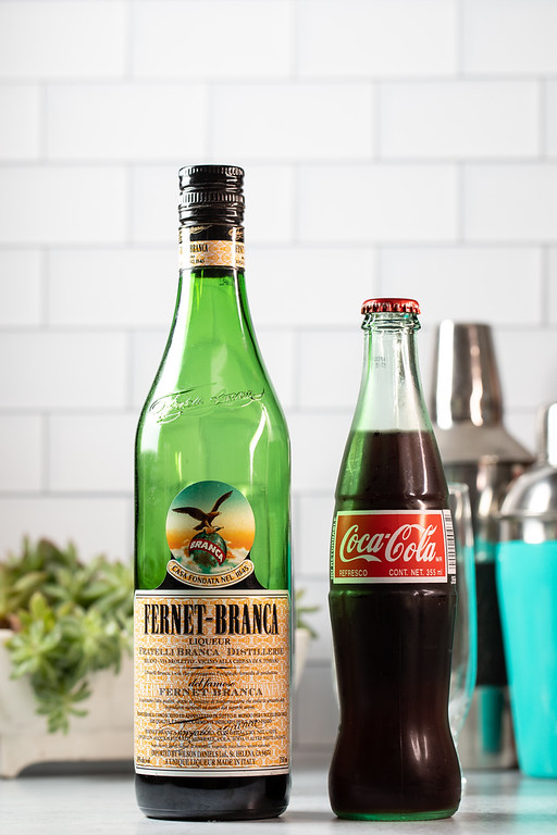A bottle of Fernet-Branca and a bottle of Coca-Cola