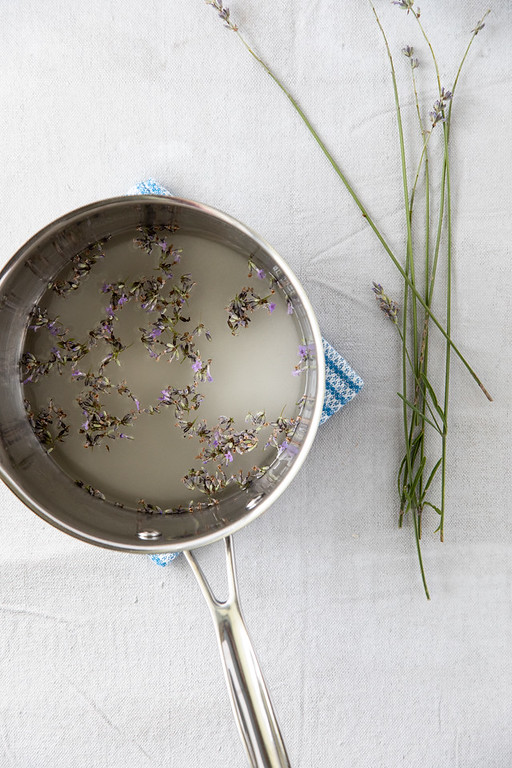 Photo showing lavender flowers in pot with water and sugar.