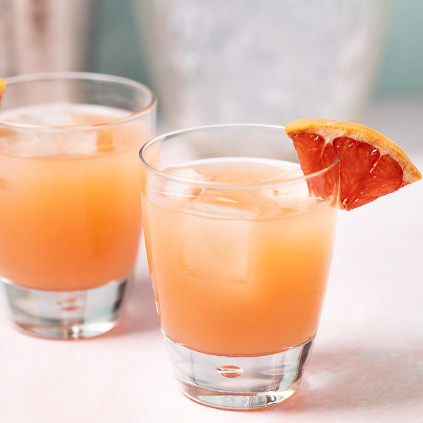 Pretty orange cocktail with a grapefruit wedge.