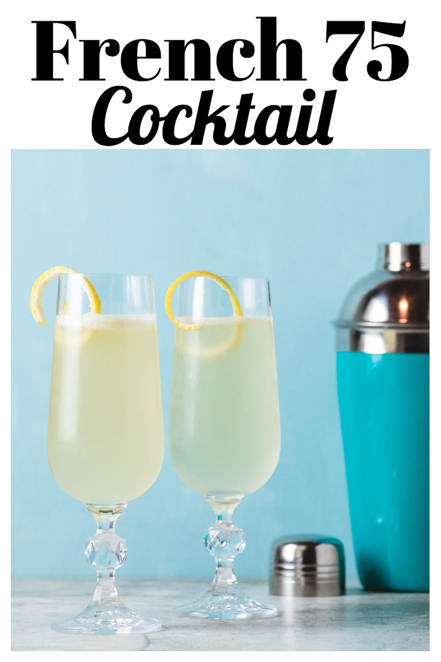 Two cocktail glasses with light yellow liquid and and a lemon twist, in front of a blue wall with a blue cocktail shaker.