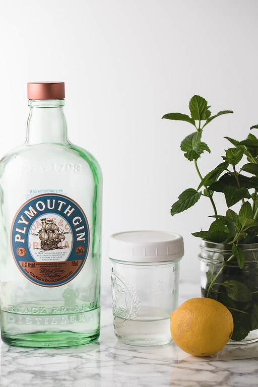 Plymouth gin, simple syrup, lemon and mint - ingredients to make a Southside cocktail.