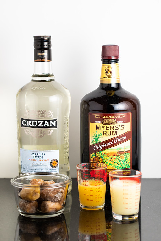 Two kinds of rum, frozen bananas, orange juice, and lime juice to make a frozen banana daiquiri.