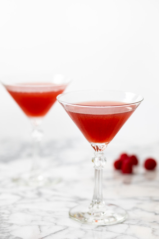 Two pink cocktails in martini glasses.
