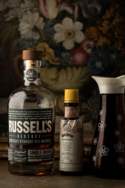 Ingredients to make a maple old fashioned - rye whiskey, angostura bitters and maple syrup.