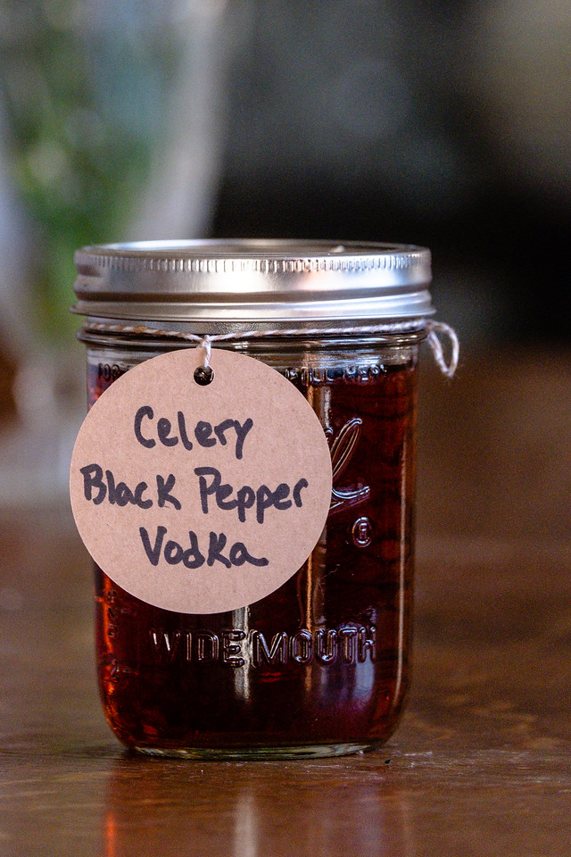 Canning jar filled with a brown liquid and a round brown tag that reads Celery Black Pepper Vodka