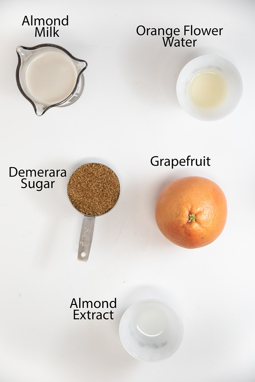 Ingredients to make orgeat: almond milk, orange flower water, demerara sugar, grapefruit and almond extract.