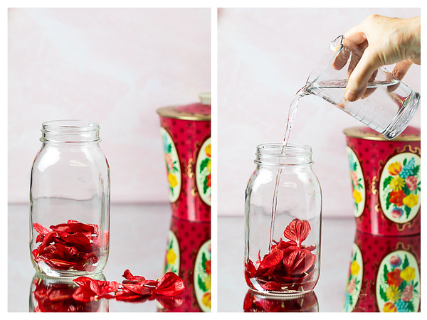 Photo collage showing red hibiscus flowers petals in a jar and vodka being poured in the jar.