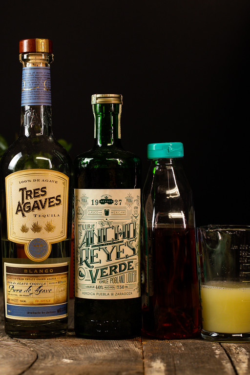 Tequila, Ancho Reyes Verde Liqueur, agave nectar and lime juice.