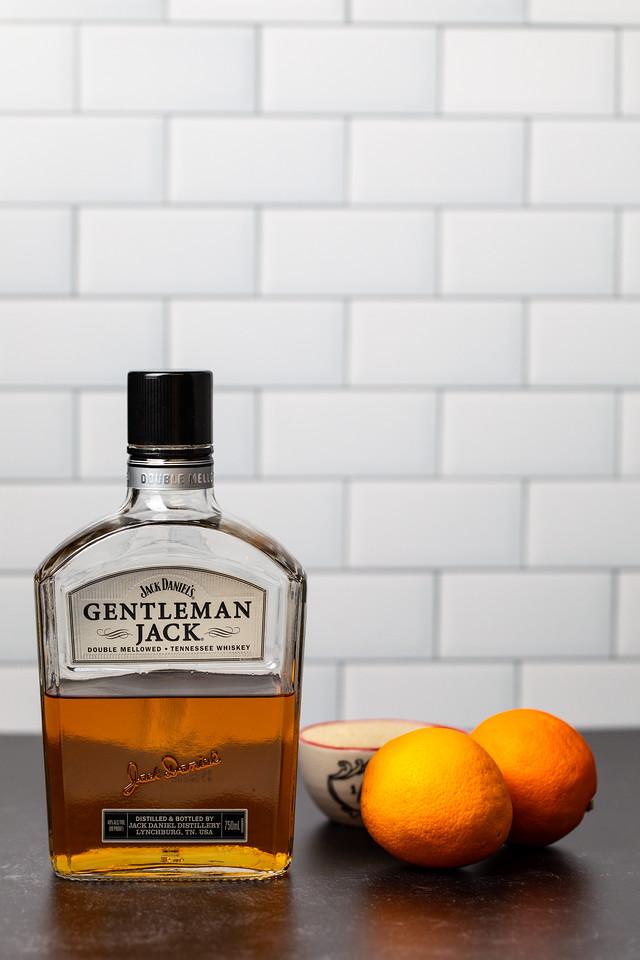 Gentleman Jack whiskey and 2 oranges.