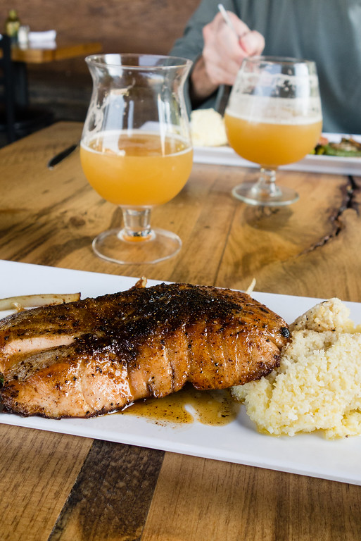 Bourbon Glazed Salmon with vegetables and grits from Monkey Town Brewing