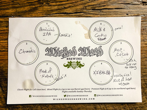 Paper of Wicked Weed beer flight samples