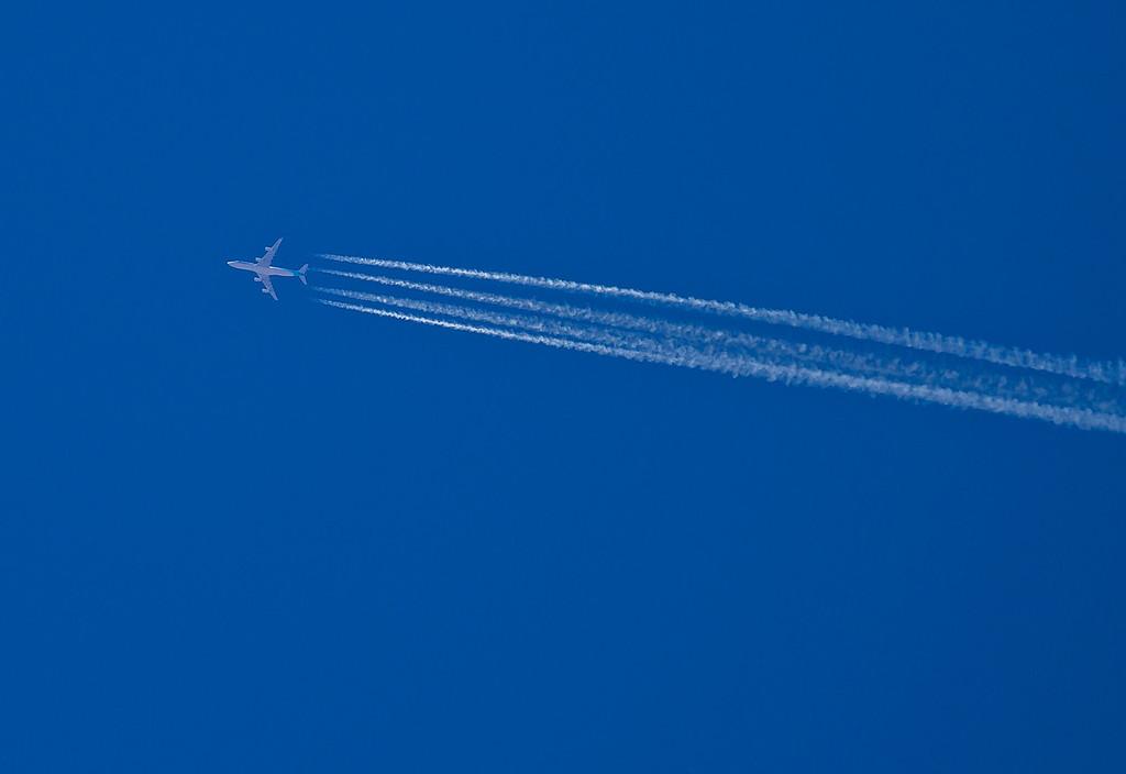 Looks like it is a Korean Air 747 high above the Arizona desert.  Hoover Dam, AZ
