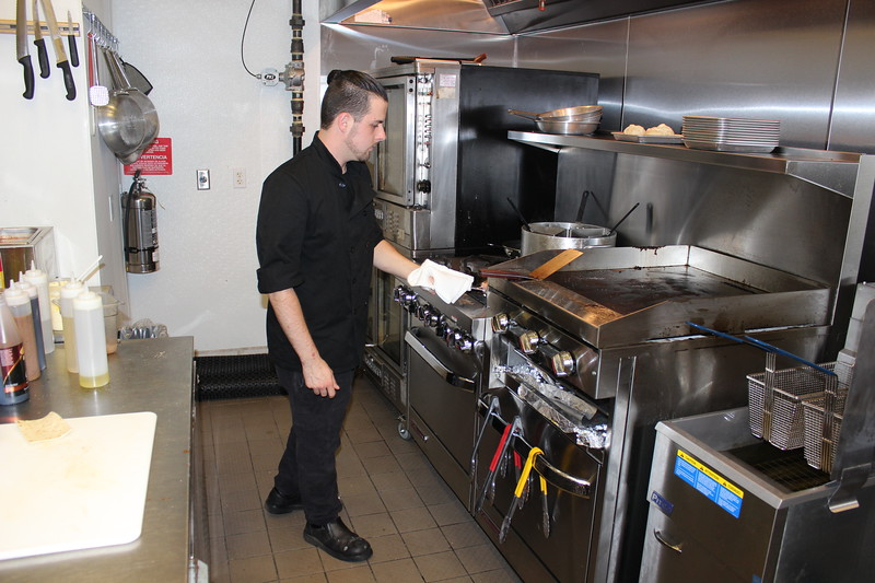 Casa Di Vino Winery and Restaurant Executive Chef Christopher Fortney prepare the popular Fisherman's Pasta on Aug 1. (Tawana Roberts–The News-Herald)