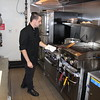 Casa Di Vino Winery and Restaurant Executive Chef Christopher Fortney prepare the popular Fisherman's Pasta on Aug 1. (Tawana Roberts–The News-Herald)