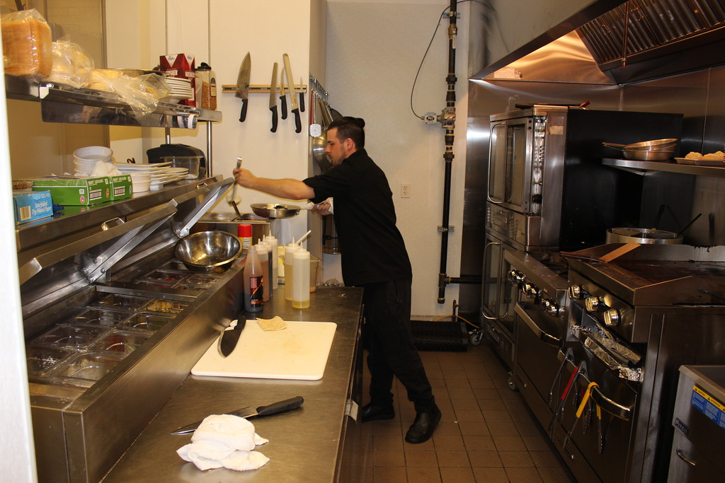 . Casa Di Vino Winery and Restaurant Executive Chef Christopher Fortney prepare the popular Fisherman�s Pasta on Aug 1. (Tawana Roberts�The News-Herald)