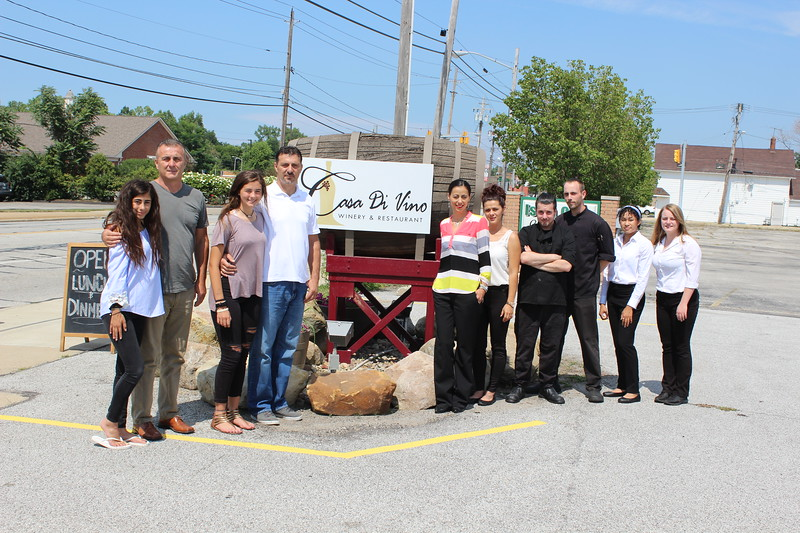 Casa Di Vino Winery and Restaurant owners, staff and family pose outside of the new eatery in Wickliffe on Aug 1. (Tawana Roberts–The News-Herald)