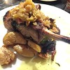 Mark Meszoros -- The News-Herald<br /> Hook & Hoof's Tomahawk Pork Chop is an impressive cut of meat.