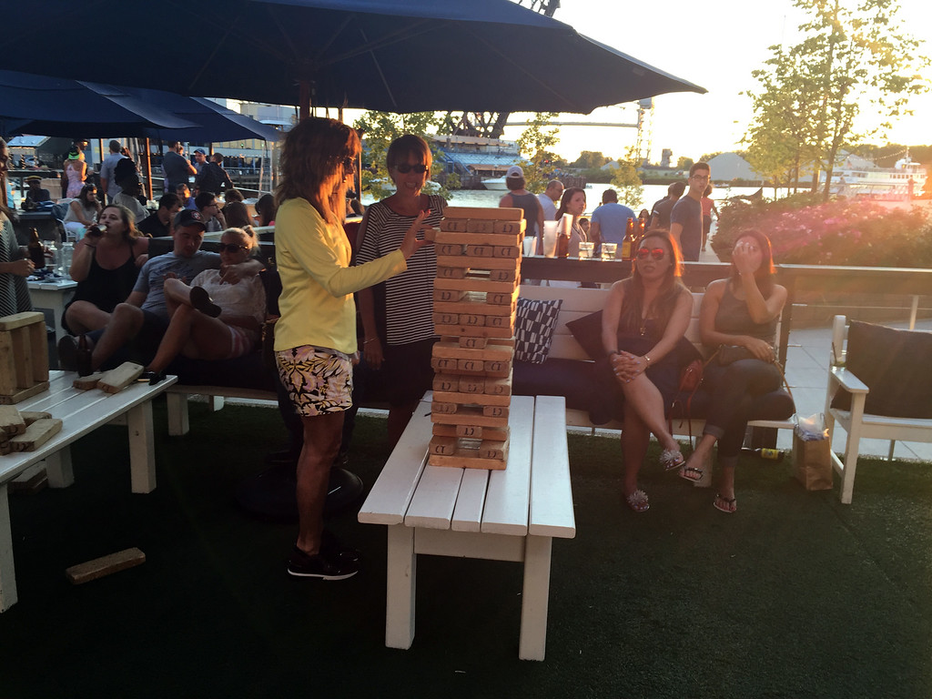 . Mark Meszoros -- The News-Herald Guests enjoy oversized Jenga and other games on the deck at Coastal Taco.