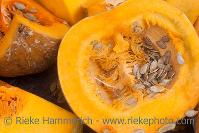Cross section of pumpkin with seeds - Farmer's market in San Jose, Costa Rica
