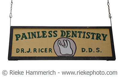 vintage sign of a dentistry - Note to reviewers: name is phantasy, not the real name - on a wooden board - adobe RGB