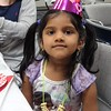 Courtesy Mentor Public Library | Diya Kumar shows off the hat she made during the tea party at Mentor Public Library.