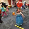 Courtesy Mentor Public Library | Payton Wagner plays in the balloons during an un-birthday party at Mentor Public Library.
