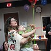 Courtesy Mentor Public Library | Amy Raischel, the children's library associate who organized the un-birthday party, helps Gabriel reach the piñata