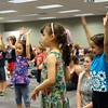 Courtesy Mentor Library | Kids dance during Tom Sieling's concert that kicked off summer reading at Mentor Public Library.