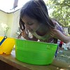 Courtesy Mentor Public Library | Hailey Bogo holds back her hair while bobbing for Brussels sprouts.