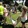 Courtesy Mentor Public Library | The teams had to work cooperatively to catch water balloons in a beach towel.