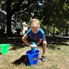 Courtesy Mentor Public Library | They run another relay race where they fill a bucket but they can only carry the water in a sopping T-shirt.