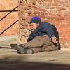 Elderley Italian Man lounging in the sun in Venice