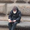Elderly Bearded Gentlemen reading a book in Florence