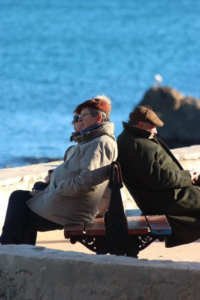 Sitting enjoying the winter sun in Antibes, France