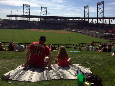 . Mark Meszoros -- The News-Herald A couple of Arizona Diamondbacks fans enjoy a game from the outfield lawn at Salt River Fields at Talking Stick in Scottsdale, Arizona.