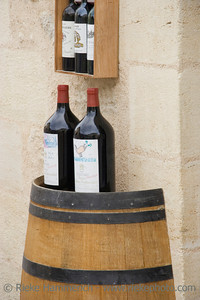 3l wine bottles on a wine cask - saint-emilion, france - adobe RGB