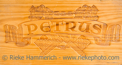 corporate logo of the famous winery chateau petrus - on a wooden wine box - adobe RGB