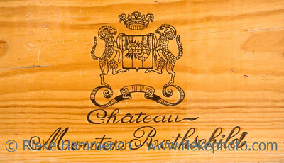 corporate logo of the famous winery chateau mouton-rothschild - on a wooden wine box - adobe RGB