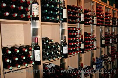 wine bottles in a rack - saint-emilion, france - adobe RGB