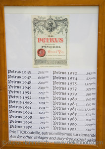 famous and expensive wine from the chateau petrus - mature bottles are very expensive - price tags found in saint-emilion, france, europe - adobe RGB