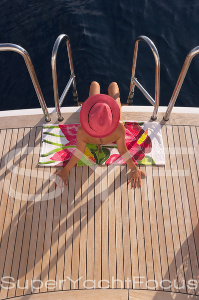 Swimming platform with girl in pink hat